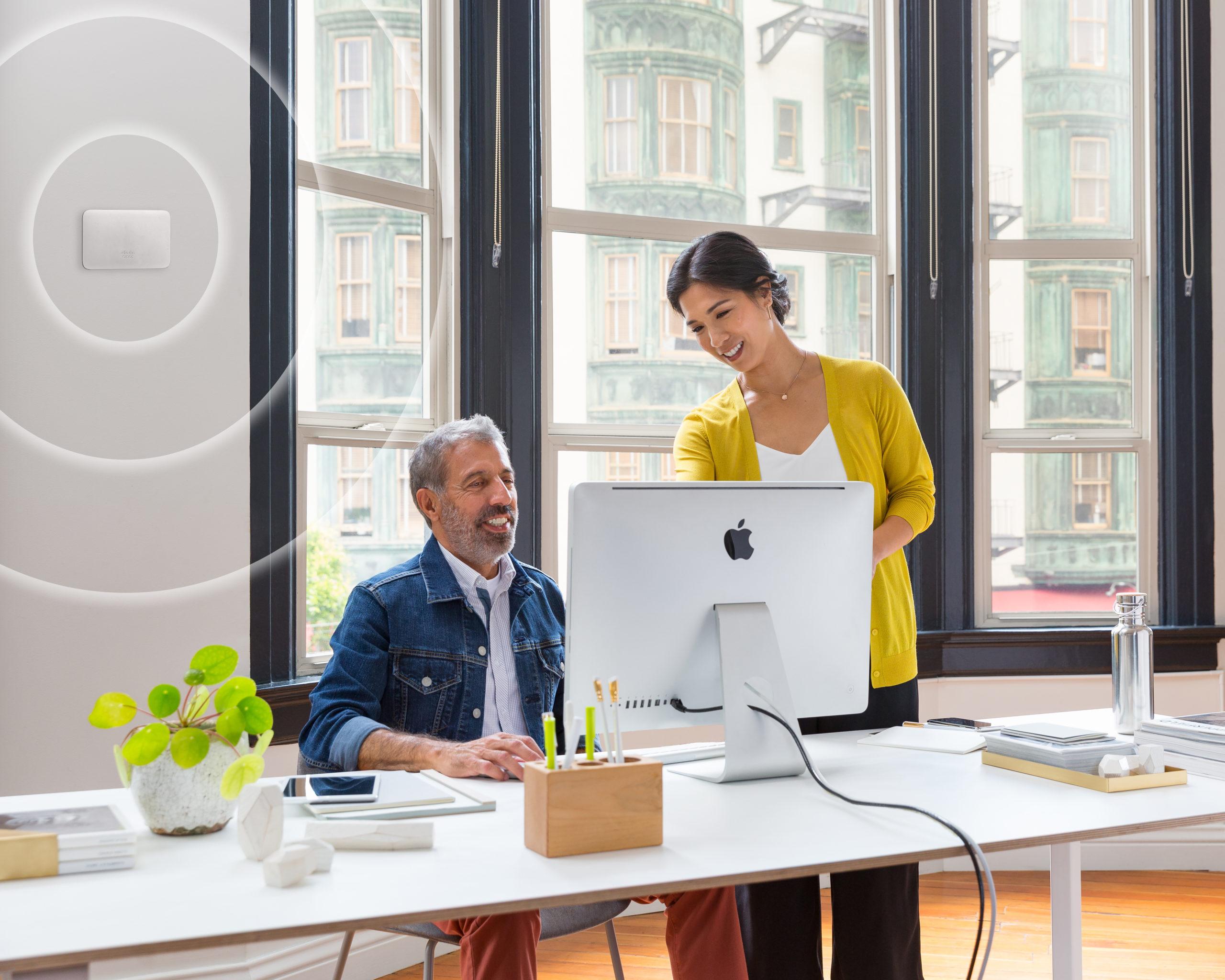 Man and woman at working looking at a computer screen